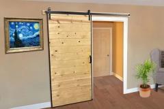 Goldberg-MP-J-Strap-barn-door-hardware-beige-wall-wood-floor