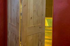 Barnfold hardware on unfinished wood door