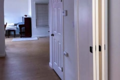 a custom Barnfold installation where all four door panels open to one side