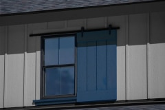 6004ES4-exterior-dummy-hardware-single-shutter-on-gray-house-with-blue-shutter