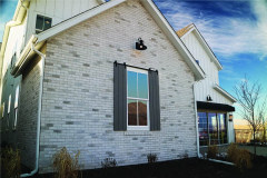 exterior-Dummy-Roller-Series-hardware-on-gray-brick-house