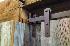 MP Series hardware with Rustic Brown finish on reclaimed barn wood doors