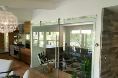Stainless Steel hardware on glass barn door