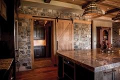 Standard Series hardware on rustic wood door in kitchen