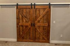 Standard Series hardware on biparting British brace barn doors