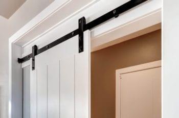 white sliding door with black barn door hardware