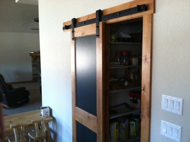 sliding pantry door with black barn door hardware