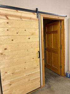 wood sliding door display in a building supply store