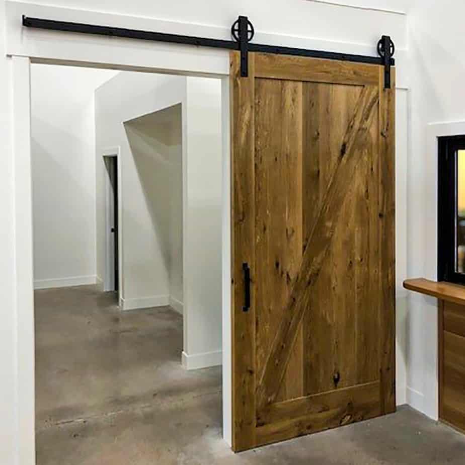 interior barn door with Goldberg Brothers Standard Series wagon wheel hardware