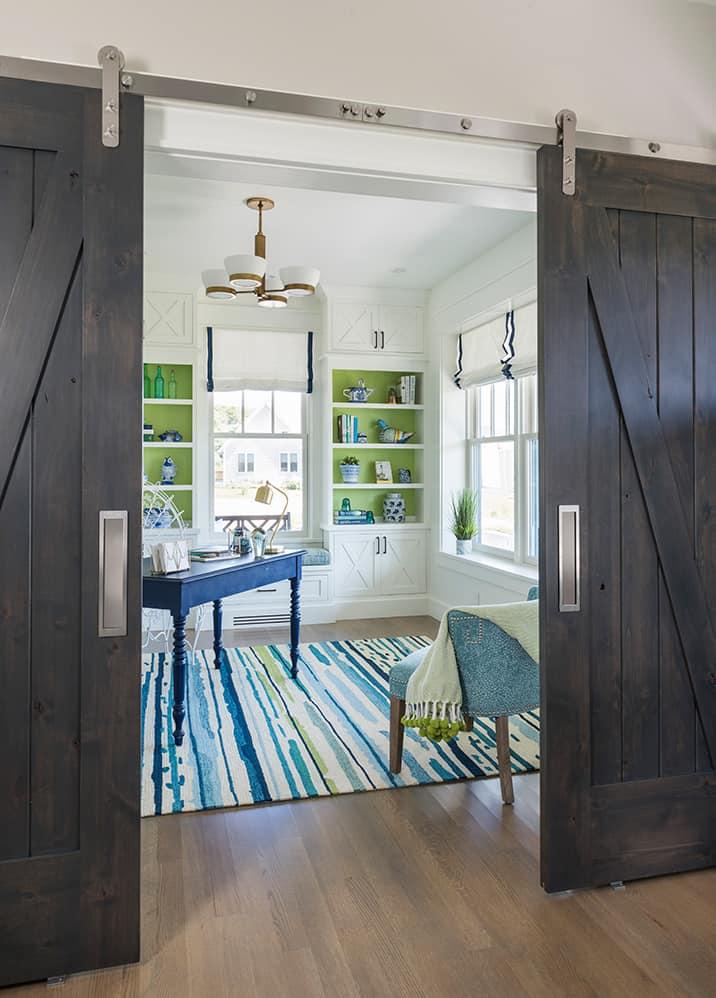 stainless steel barn door hardware on dark wood door