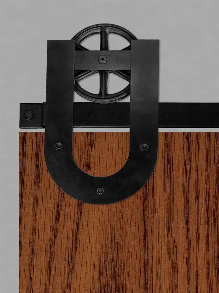barn door hardware with horseshoe wagon wheel hanger