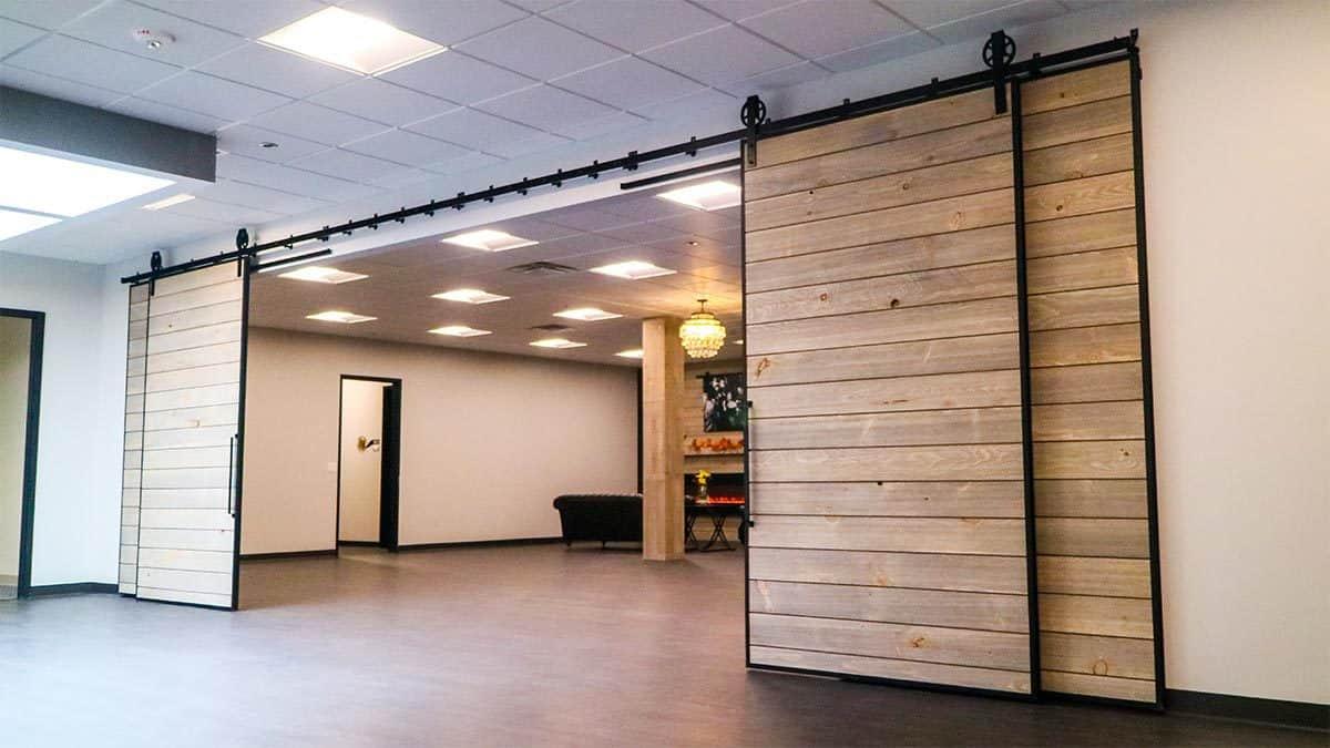 four large sliding doors with black barn door hardware