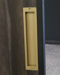 gold-colored steel flush pull handle on office door