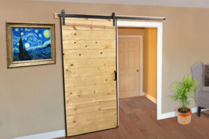 an home interior barn door with steel Barn Door Edge Wrap channels and Goldberg Brothers barn door hardware