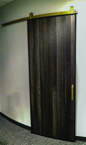 curved wall and sliding curved door made with Goldberg Brothers Barn Door Edge Wrap, in fully closed position