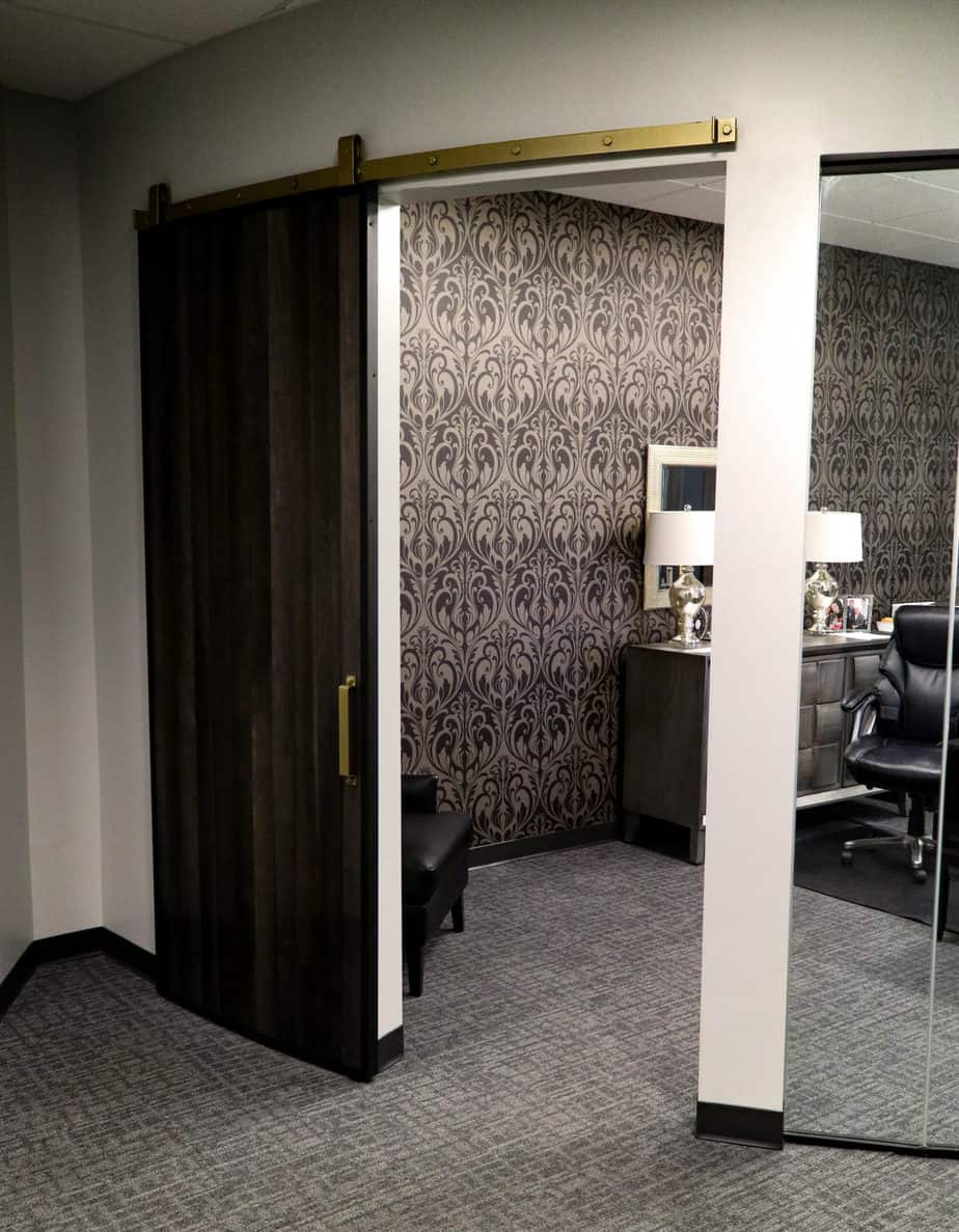 curved wall and sliding curved door made with Goldberg Brothers Barn Door Edge Wrap, in fully opened position