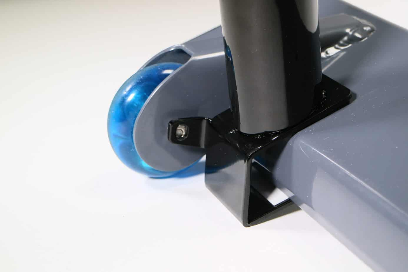 A black steel accessory bracket mounted on the base of a gray exercise equipment device