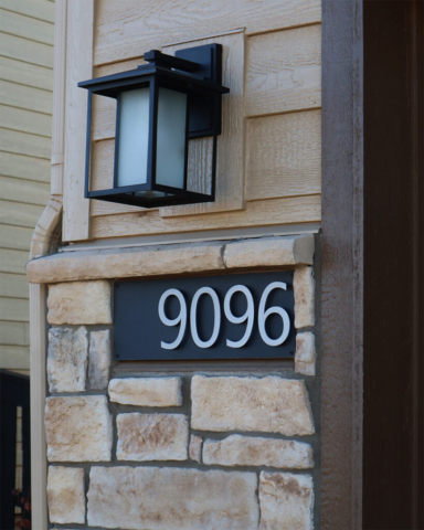 house number sign on house with block siding