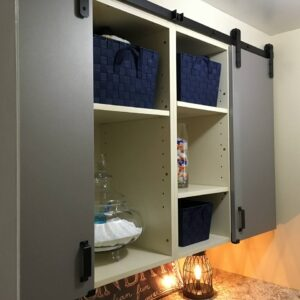 Laundry room cabinetry with Goldberg Brothers shutter series barn door hardware and MClad® cabinet panel facing