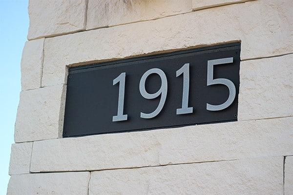 Goldberg Brothers house number sign on house exterior
