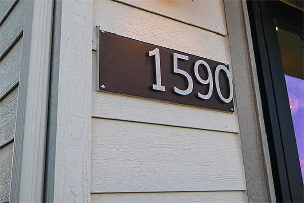 goldberg Brothers house number sign on wood siding